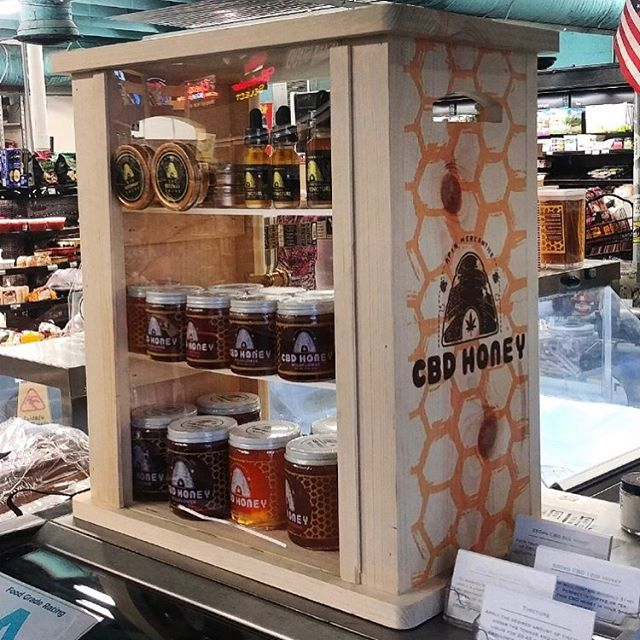 Putting the 🐝 in CBD. // Check out this custom made, customer designed display case! @apismercantile came to us with an idea to protect their honey-based products and create a beautiful display for their customers. You can find this one at @bertsmarket on Folly! // Routed wood with direct UV print and acrylic locking door.  #outsidetheboxsc #strivetobedifferent #apismercantile #charleston #follybeach #bertsmarket #concepttocreation #display #displaycase #savethebees #honey #cbd #routed #wood #acrylic #wemakecoolshit