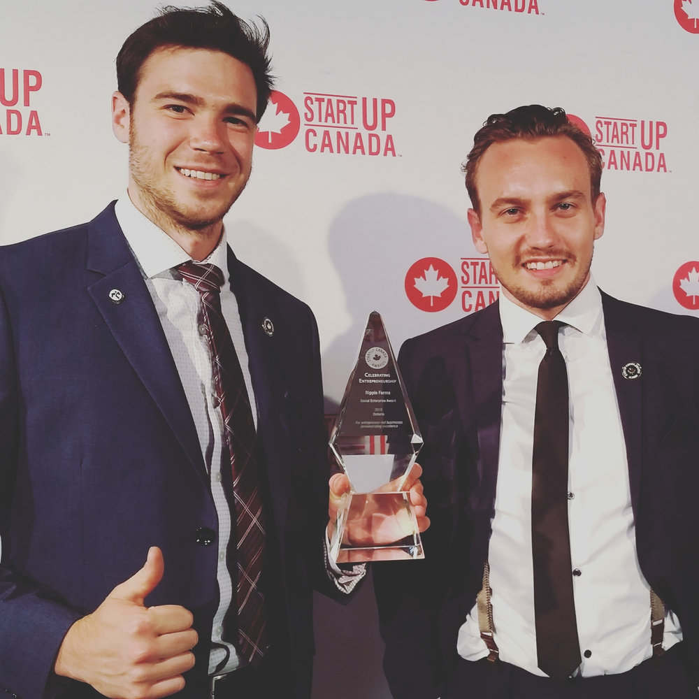 Ripple Farm founders Brandon Hebor and Steven Bourne after receiving their award.
