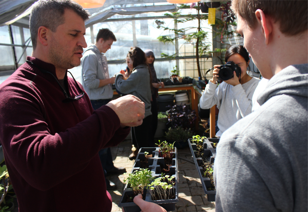 Dan Kunanec (left), inside a greenhouse at the Don Mills Collegiate Institute in Toronto, Canada.