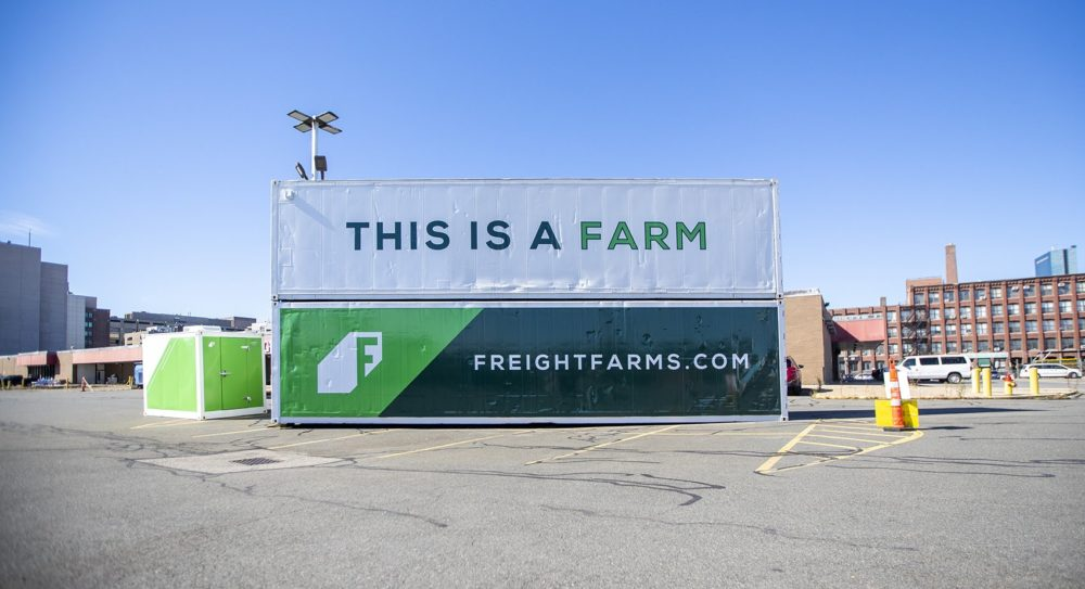 Two Freight Farms Leafy Green Machines sit stacked in a parking lot near their headquarters in the South End of Boston. (Jesse/CostaWBUR)