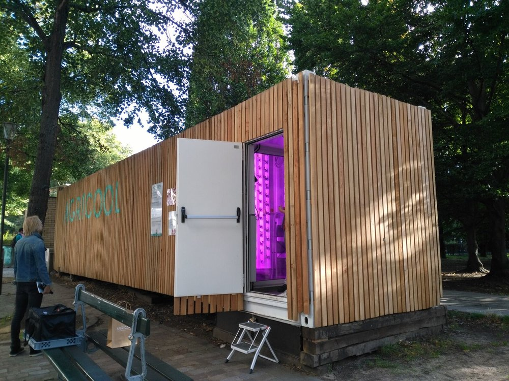 "An Agricool ""Cooltainer"" on display in Paris. The company installs wood-siding onto its container farms so that they better integrate with their surrounding environment."