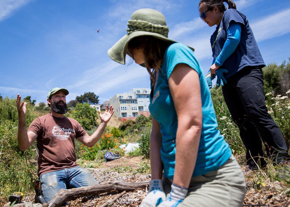 Chris Chimenti (left) giving a lesson on farming techniques.
