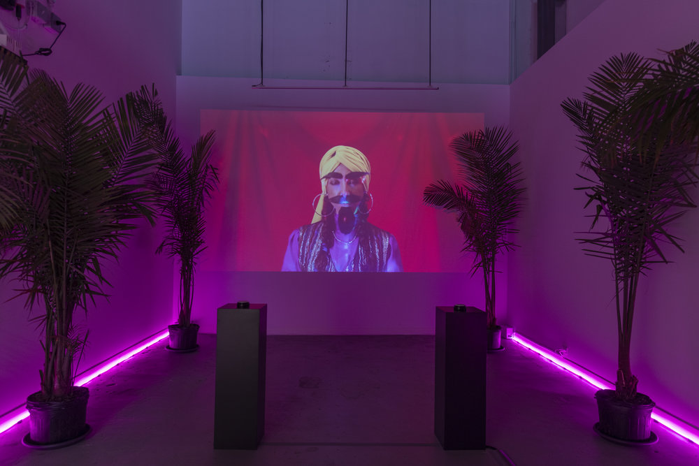 Lara Nasser,  Fortune Teller , 2018, interactive video installation (raspberry pi, software, palms, neon lights, pedestals, buttons with text), dimensions variable, photo: Adam Reich