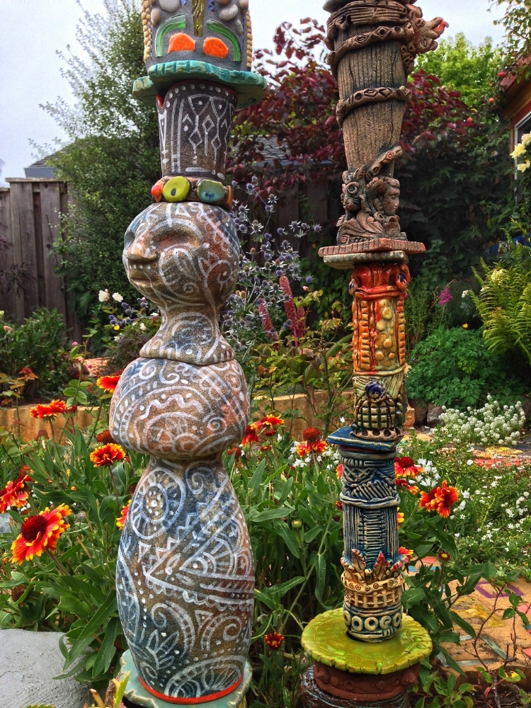Detail. Mrs. Butterworth. 3 garden totems.
