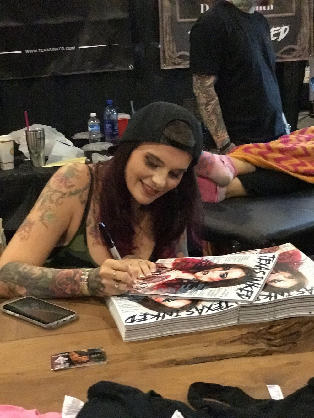 Our cover girl,  Liz Cook  signing some magazine.