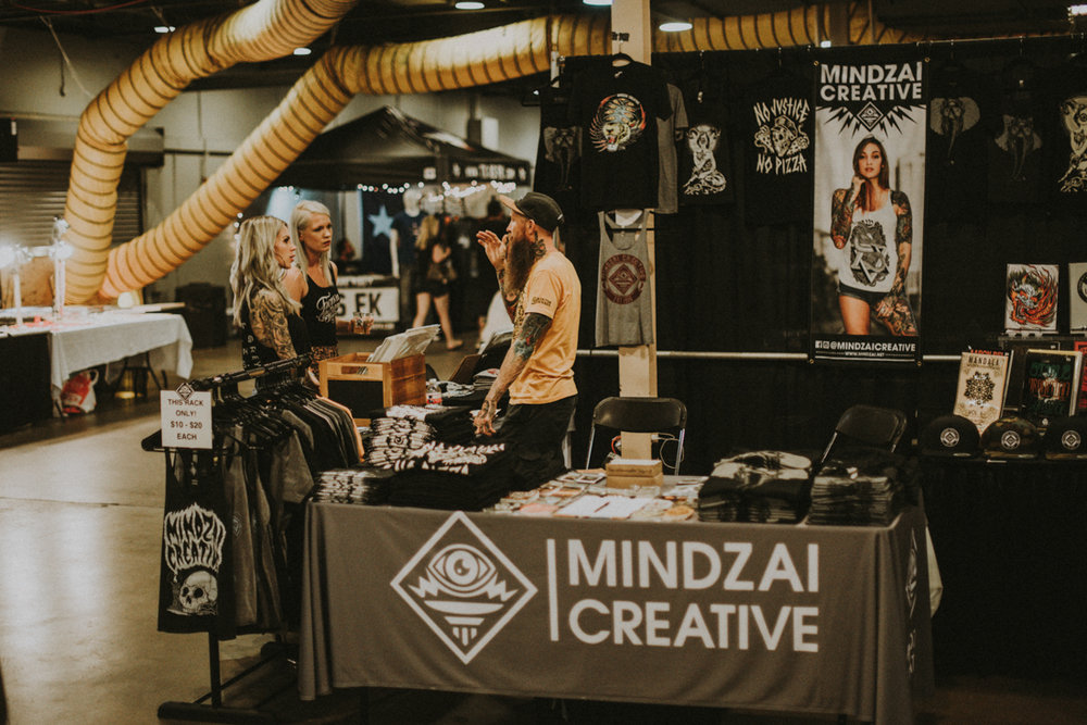 Mindzai Creative  talking with customers.