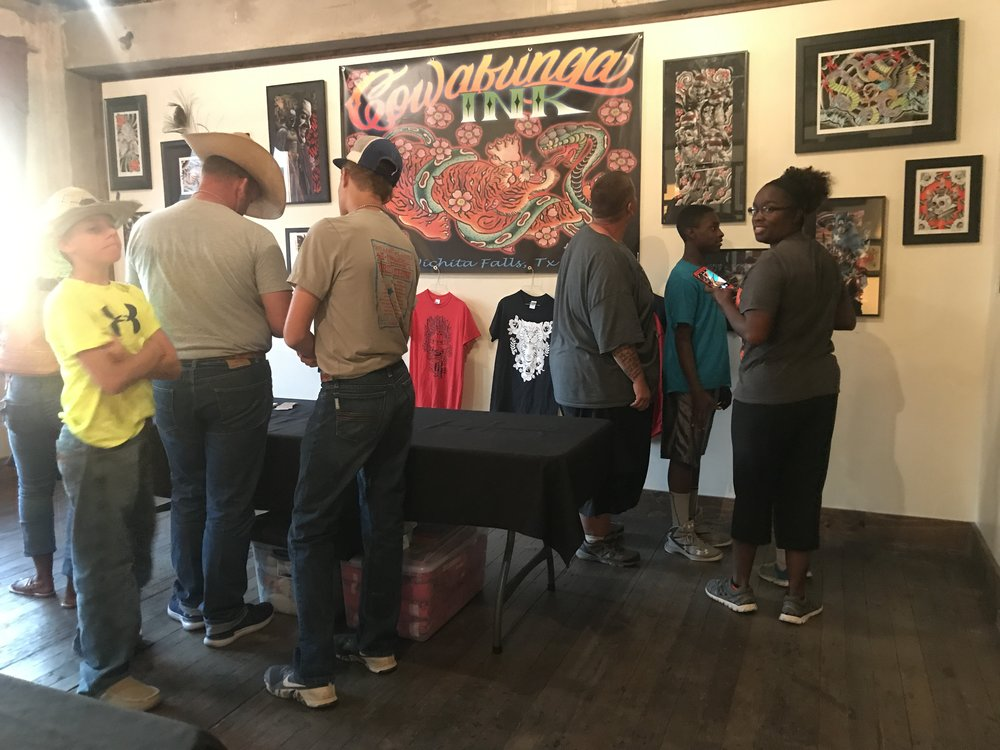 Onlookers at Cowabunga Ink's setup