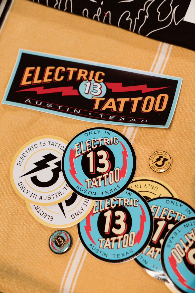 Pins and stickers from Electric 13 Tattoo in Austin