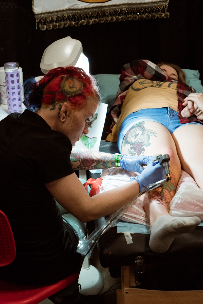 Tank Girl working on a beautiful luna moth shin piece. Find her at True Blue Tattoo in Austin