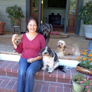 "Ann Falletta-Cowden Director of Operation, Sonoma   Ann joined the Pet Indulgence staff in May 2012 and became Director of Operations in Sonoma County in 2015. In addition to sharing her home with a variety of animals large and small, from pet mice and tree frogs to dogs and cats, her experience with animals includes volunteer work, walking dogs, fostering, and helping with adoptions. Her dog Charlie became a family member after he overstayed his fostering and demonstrated his willingness to be ""third dog"". She appreciates the opportunity to help pet owners with their beloved pets, and treats her charges as family. Ann has some Reiki and Homeopathy experience, has attended seminars on dog behavior, and is First Aid and CPR certified for dogs and cats. She lives in Petaluma with her family, which includes 3 dogs, a spotted python, and 11 chickens."