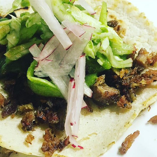 Carnitas, picked celery root, cabbage, green apple, radish, and mole verde on fresh tortilla