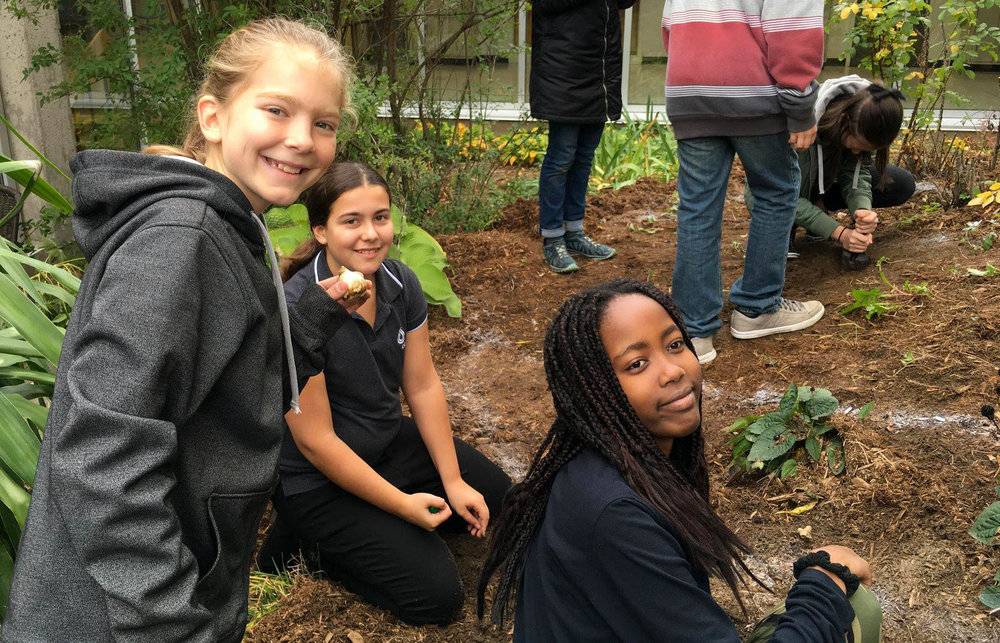 ESCJ Students Planting Bulbs.jpg