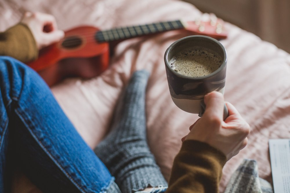 holding-coffee-in-bed_4460x4460.jpg