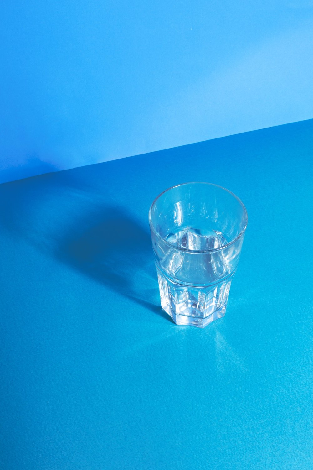 clear-water-glass-reflecting-on-blue_4460x4460.jpg