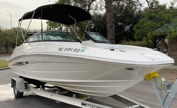 2014 SEA RAY 220 SUNDECK OUTBOARD - 2014 Sea Ray 220 Sundeck Outboard 250XL Mercury Verado Four stroke (6k Upgrade from the factory) Digital Throttle and Shift with power steeringWhite HullIvory Interior with black trim accents and black Sea Ray logo embroideryMore Info →