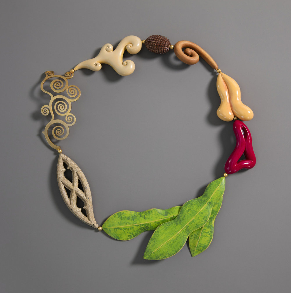 Fulfillment Necklace - Designed by Bruce Metcalf, 2004. Carved and painted maple, gold-plated brass, painted wood, plexiglass (case).