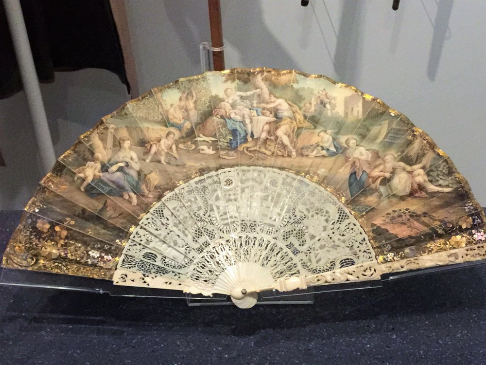 Luxury Objects - The use of carved ivory, baleen, tortoise shell elevates objects such as this fan from practical to luxury items.