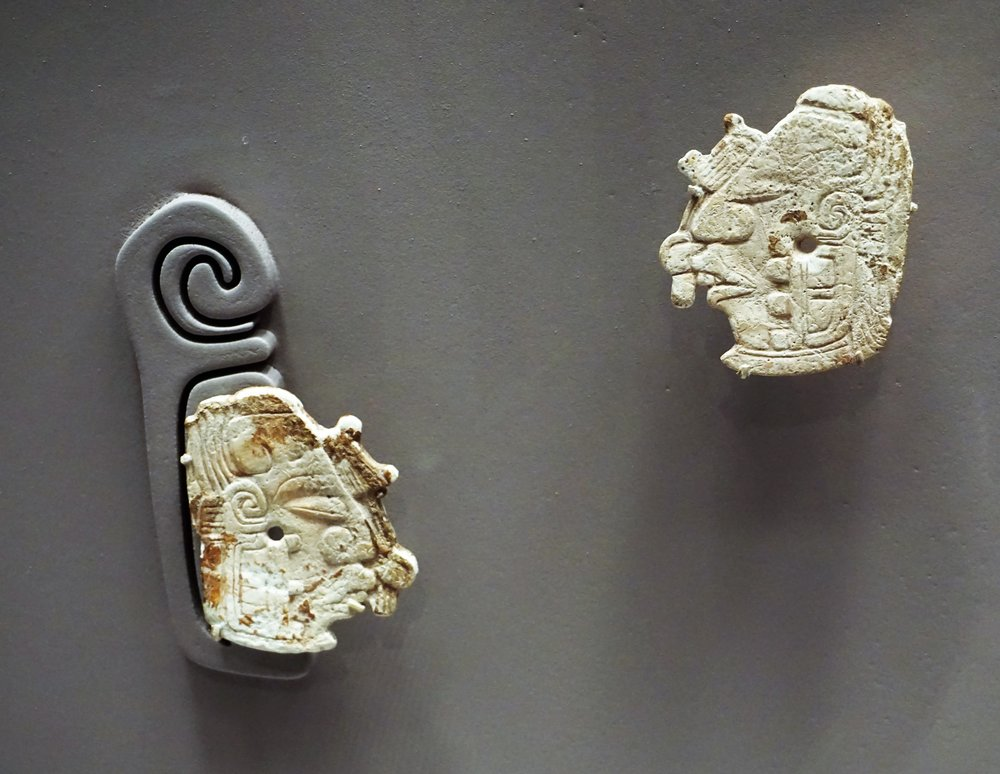 Pair of Earflare Frontals, 5th-7th century, Shell. Wispering into the ear of the king.