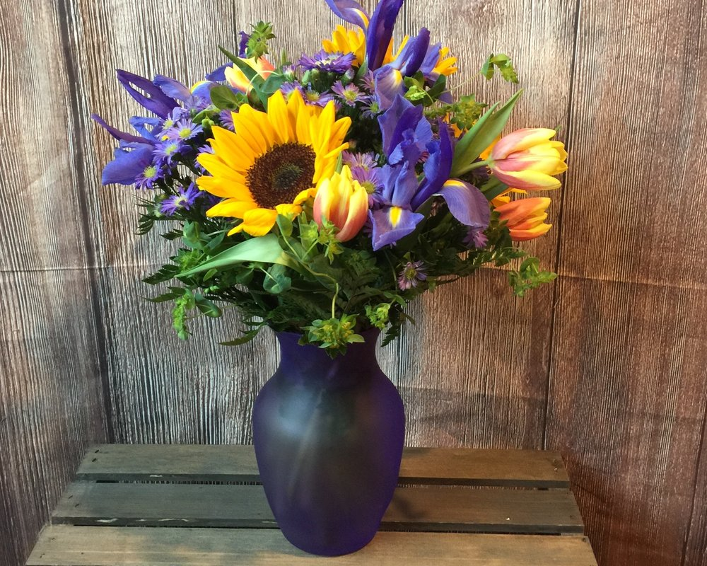 PURPLE ENVY - Arrangements starting at $50.00 and up.Substitutions may be made upon availability, similar keepsake/similar product similar flowers (style, color, & value)