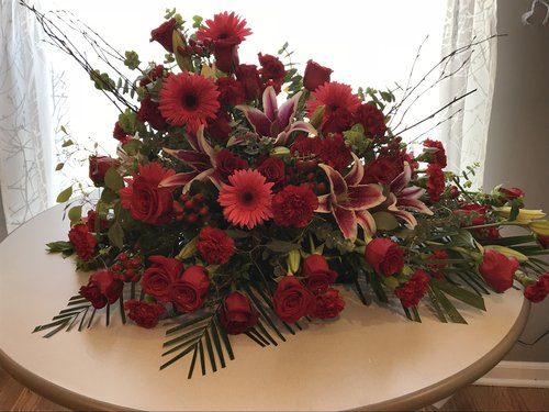 Casket Spray - Starting Price:$285.00 and UpRed Rose,Stargazer lily, Pink Gerbera Daisy, Red Carnation, Spiral Euk, Seeded Euk.