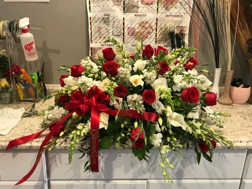 Casket Spray - Starting Price:$285.00 and UpRed Rose, White Orchid, White Snaps, White Stock, White Cala Lily.
