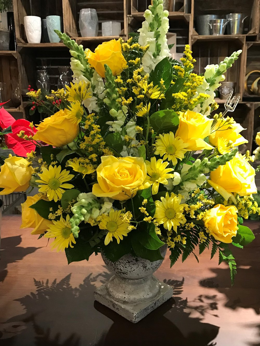 Urn Spray - $ 150.00Yellow Rose, White Snaps, Yellow Daisy, Solidago.