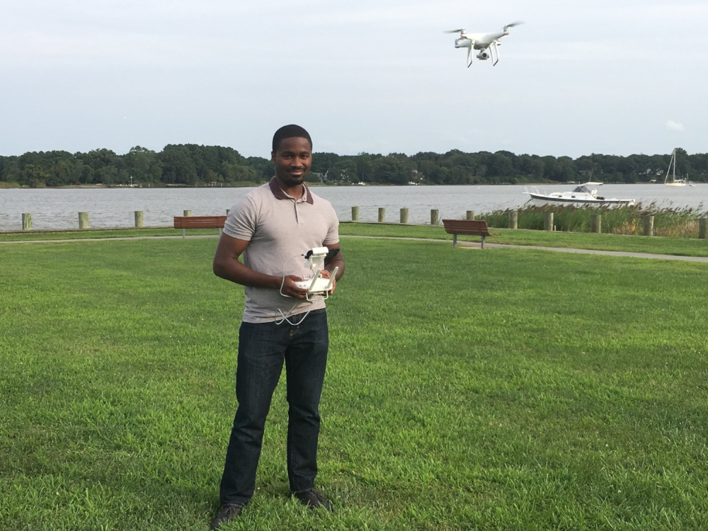 Shoge standing with drone in Wilmer Park in Chestertown, MD