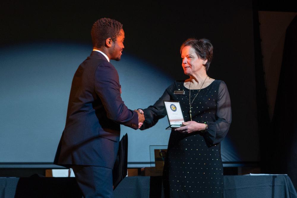 Sam Shoge Accepting Award