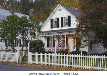 stock-photo-white-clapboard-house-with-a-white-picket-fence-46954432