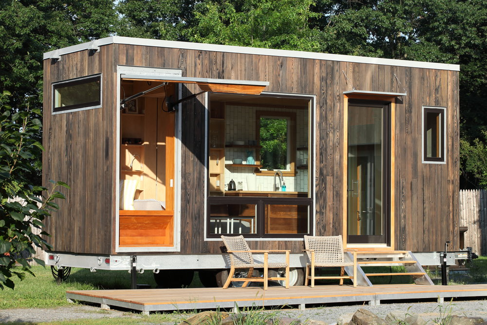 """The Sturgis,"" a 160-square foot weekend retreat, with indoor/outdoor shower, kitchen and built-in motorcycle garage."