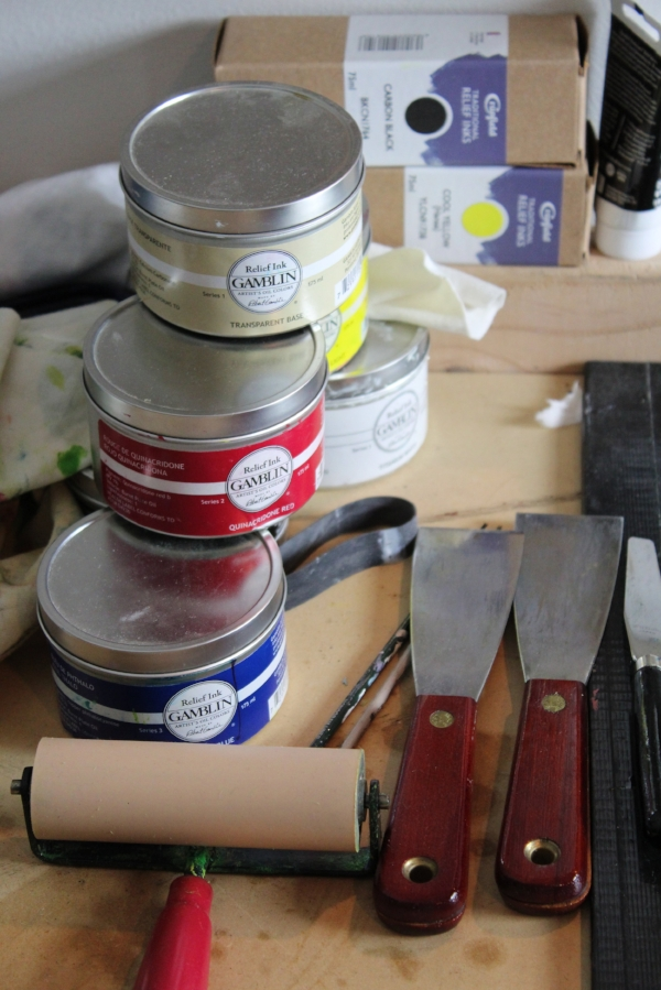 Printing inks, knives and a brayer on my printing bench. These are used in printing traditional western woodcuts.