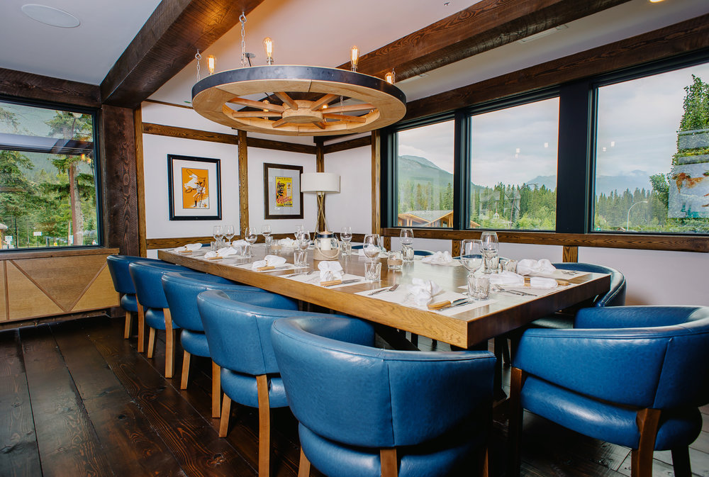 Private Dining Room - 8-12 or up to 22 PEOPLE River & mountain view windows, our hidden gem can be sectioned off with privacy curtains to seat 8-12 guests privately or the whole room can be booked exclusively to seat as many as 22 guests.
