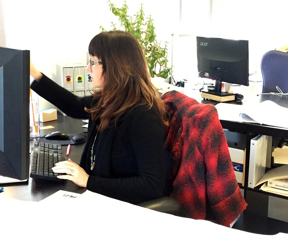 Courtney at desk.JPG