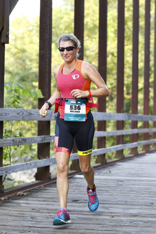 - Running with potato chips in hand at Ironman Chattanooga 2017