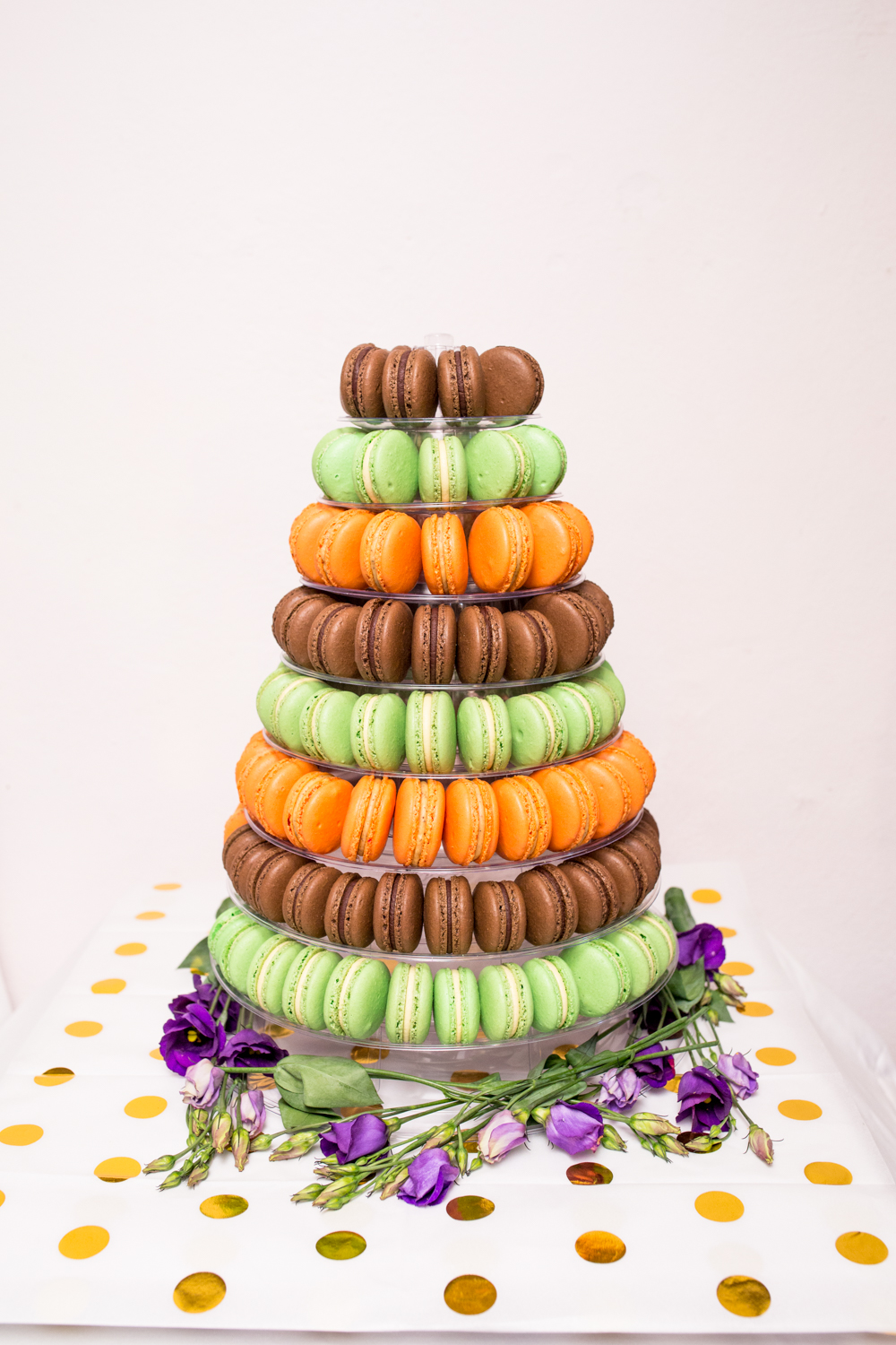 A macaron tower with an assortment of colours and flavours