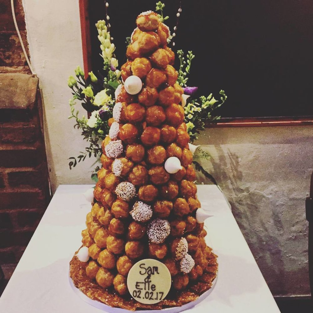 Croquembouche decorated with sugar crystals and meringues