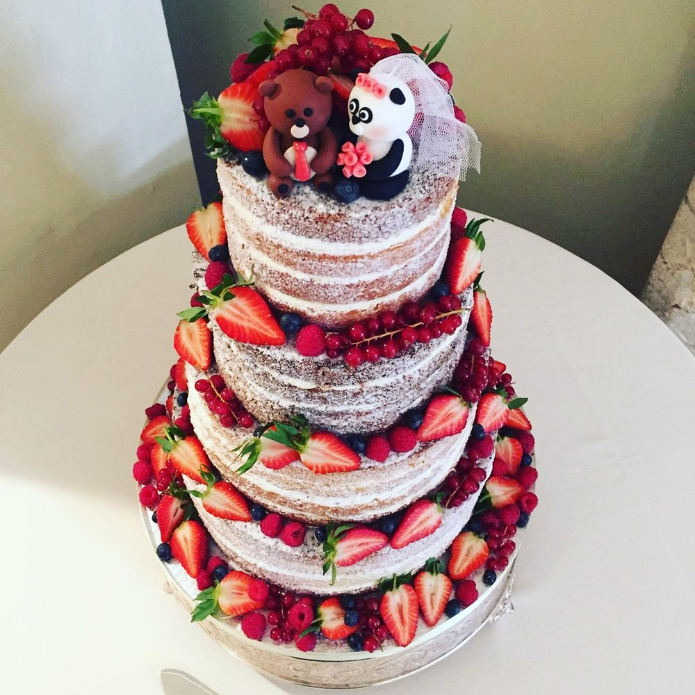 Naked cake, adorned with berries
