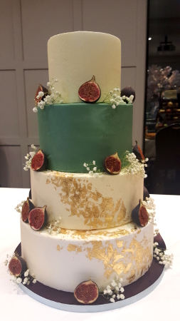 masked buttercream wedding cake with gold leaf and autumn decoration