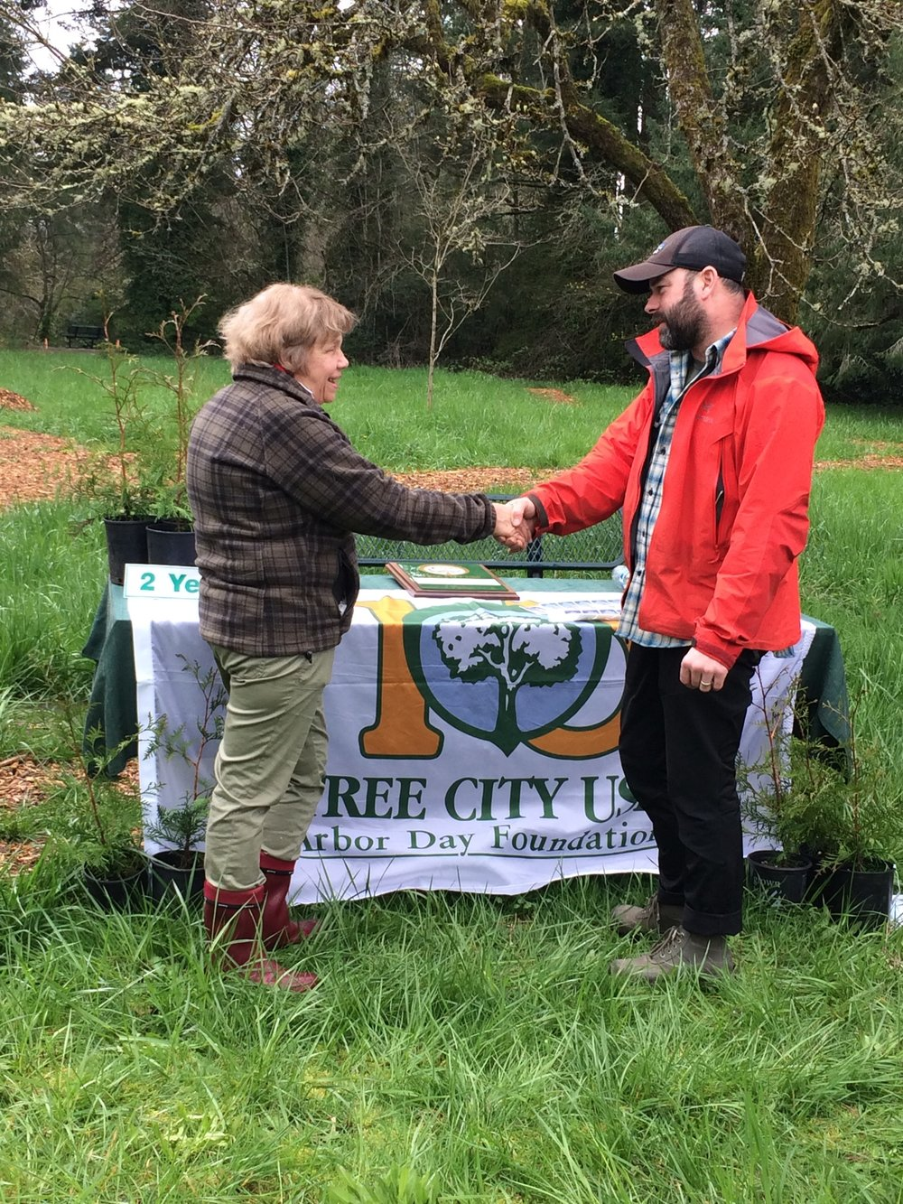 City Arborist Brian French congratulates Mayor Heather Kibbey on receiving the distinction of a Tree City USA for the second year in a row.