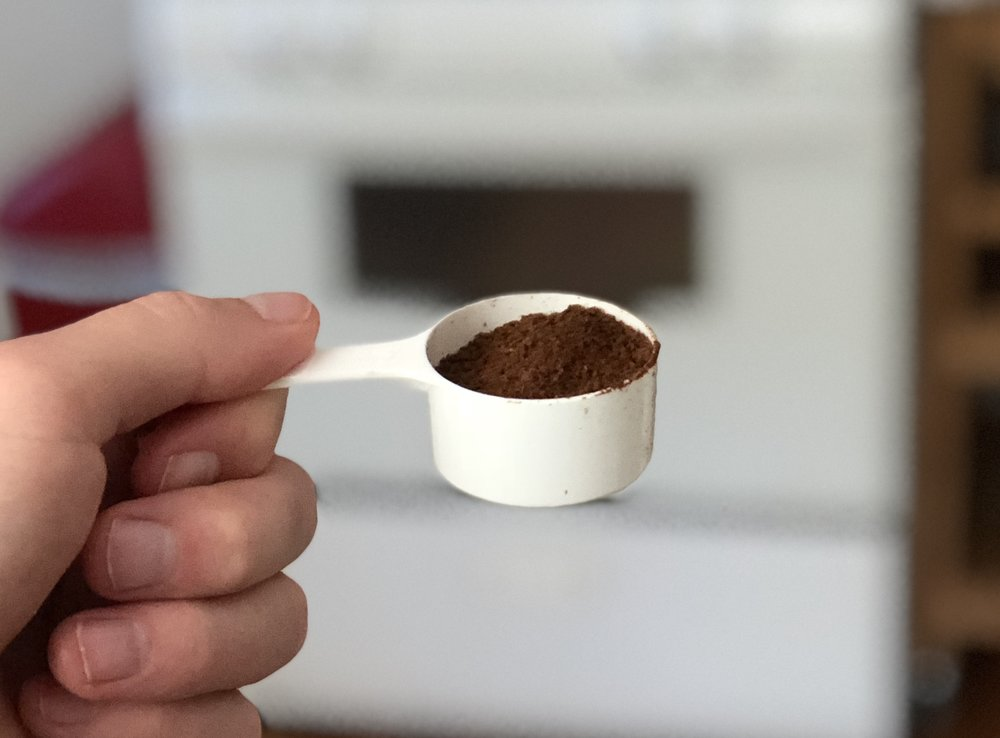 First, you grind coffee beans into a powder.