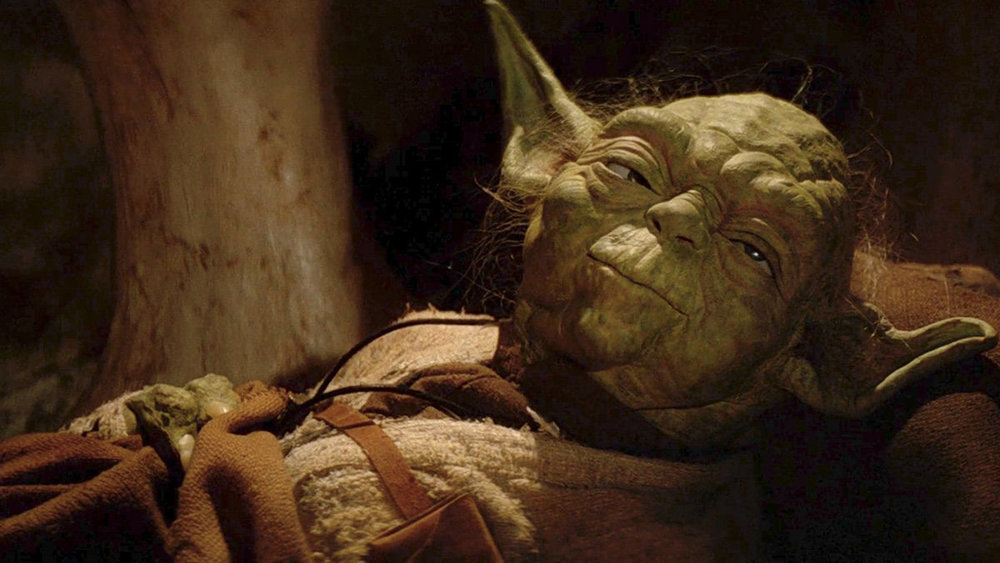 Yoda shown here either dying of thirst, or growing tired of Luke's constant whining.