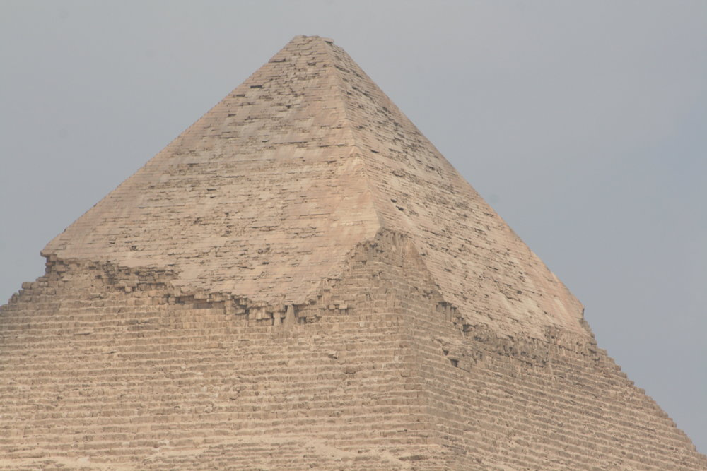 The remaining limestone cap on the pyramid of Khafre. The limestone on the pyramids at Giza can be found throughout Old Cairo, as the stone was stripped from the pyramids for construction of fortresses and mosques during the 19th century CE. Some of the limestone from the pyramids was repurposed for use in construction of the Mosque of Mohamed Ali for example.