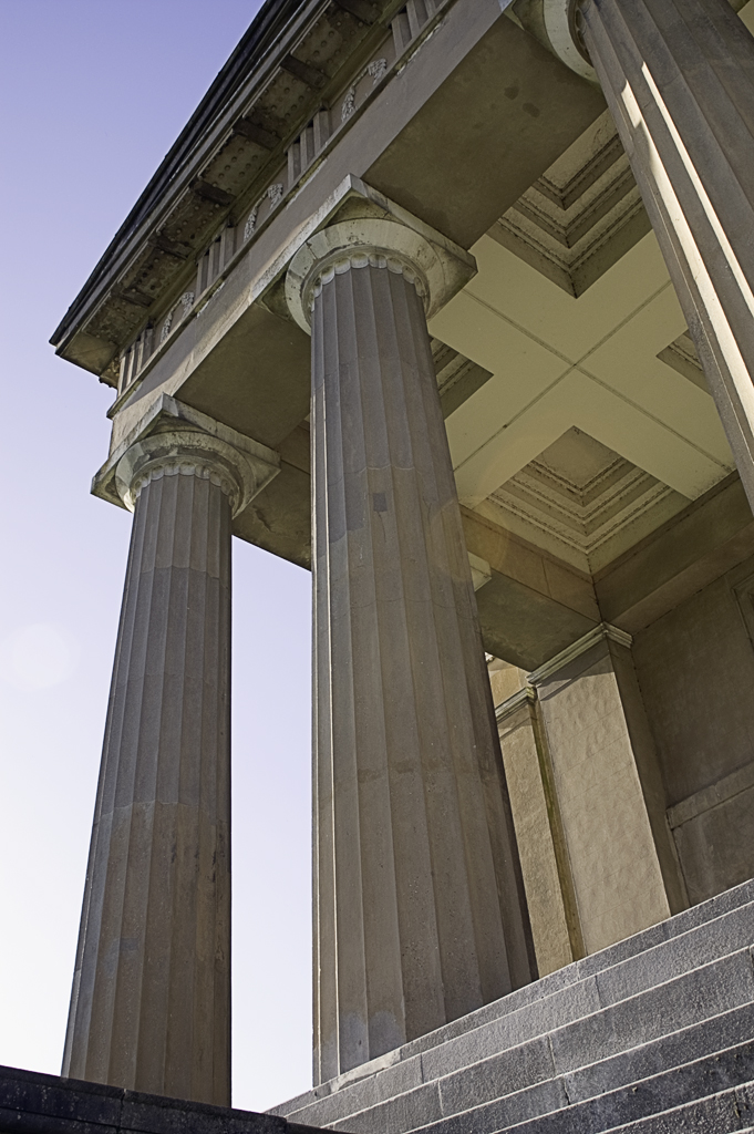 Vertical fluting on Doric order columns, possibly inspired originally from Egyptian architecture, itself inspired from pre-dynastic Egyptian use of bundled papyrus pillars.