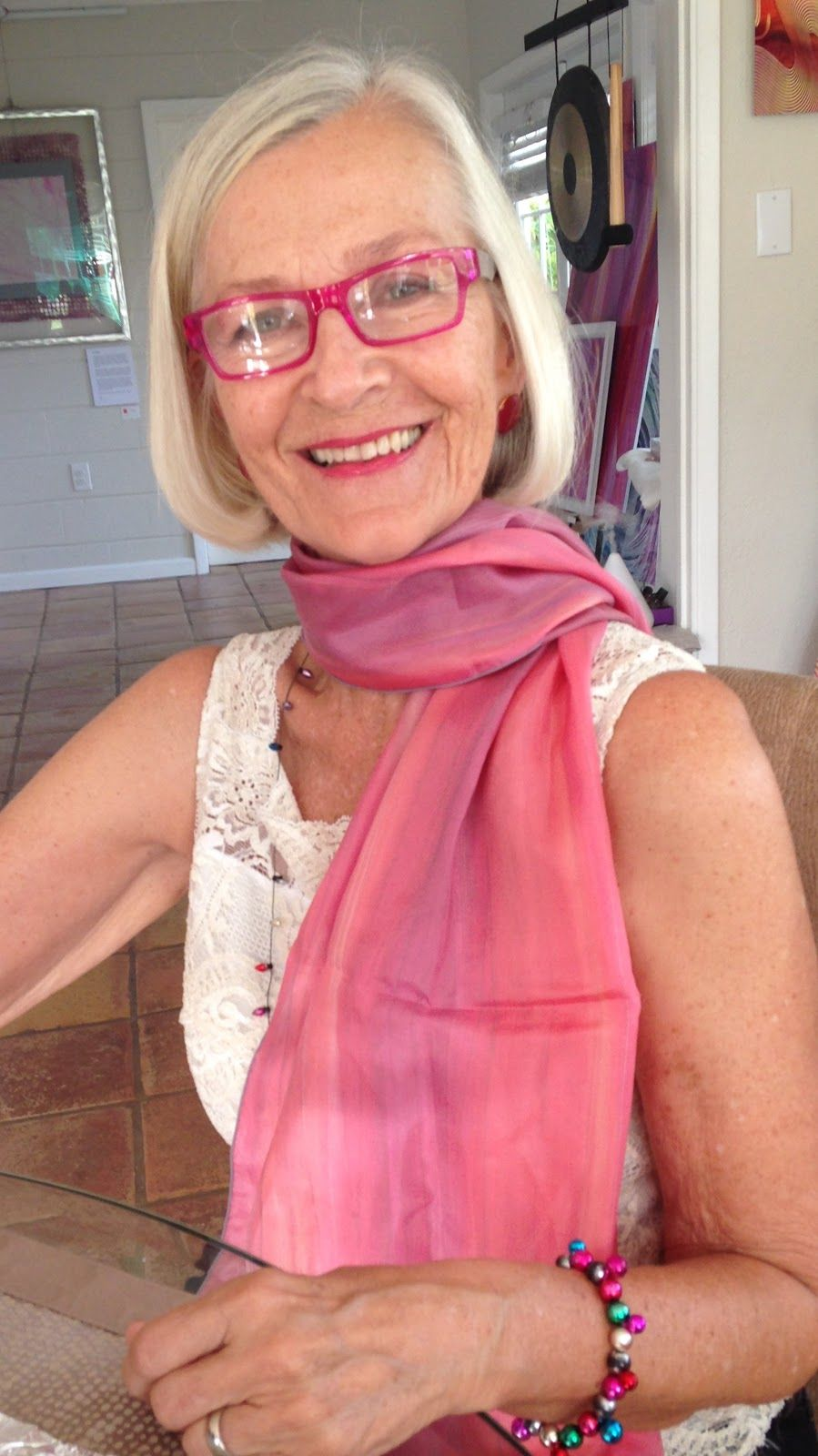"""""""Ahhh...I feel as if I am moving through life with simple elegance and mindfulness when I am wearing Lisa's scarf, Grace.""""     - Pat wearing the Grace scarf"""