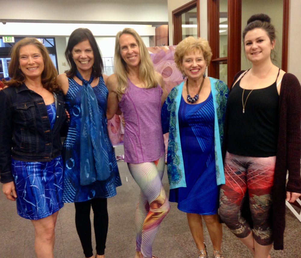 Lovely ladies wearing my designs - - Flight fitted dress, Mayhem flare dress with matching scarf, Empower yoga leggings, Gratitude Blue flare dress, & Odyssey classic capris -