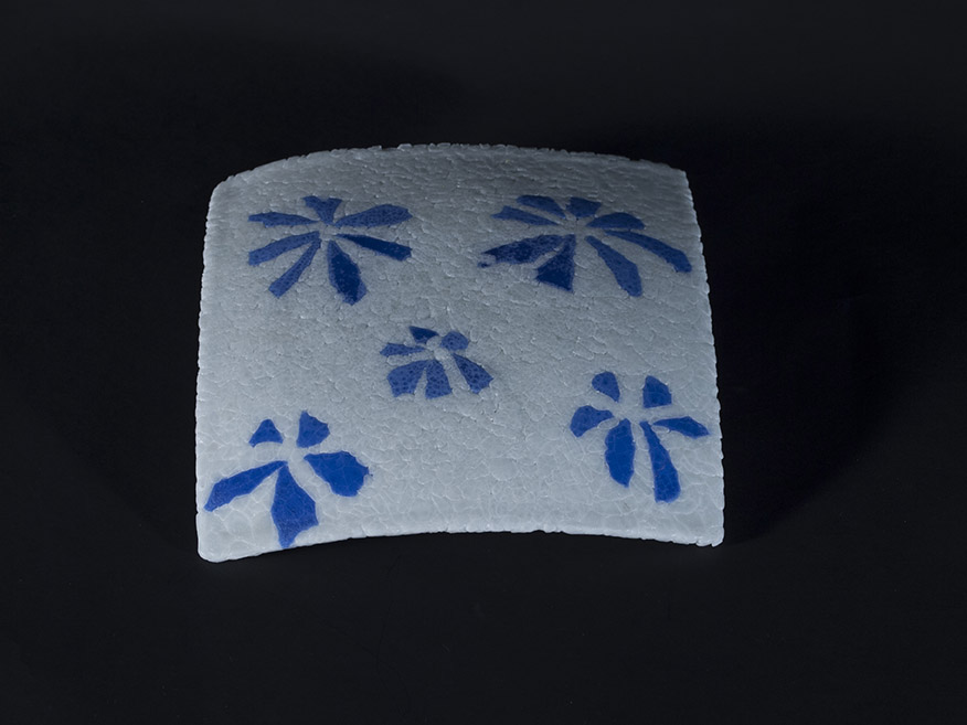 Fused and slumped, white with blue flower pattern