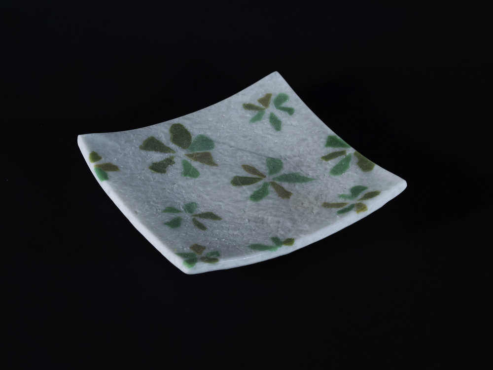 Fused and slumped, white with green flower pattern