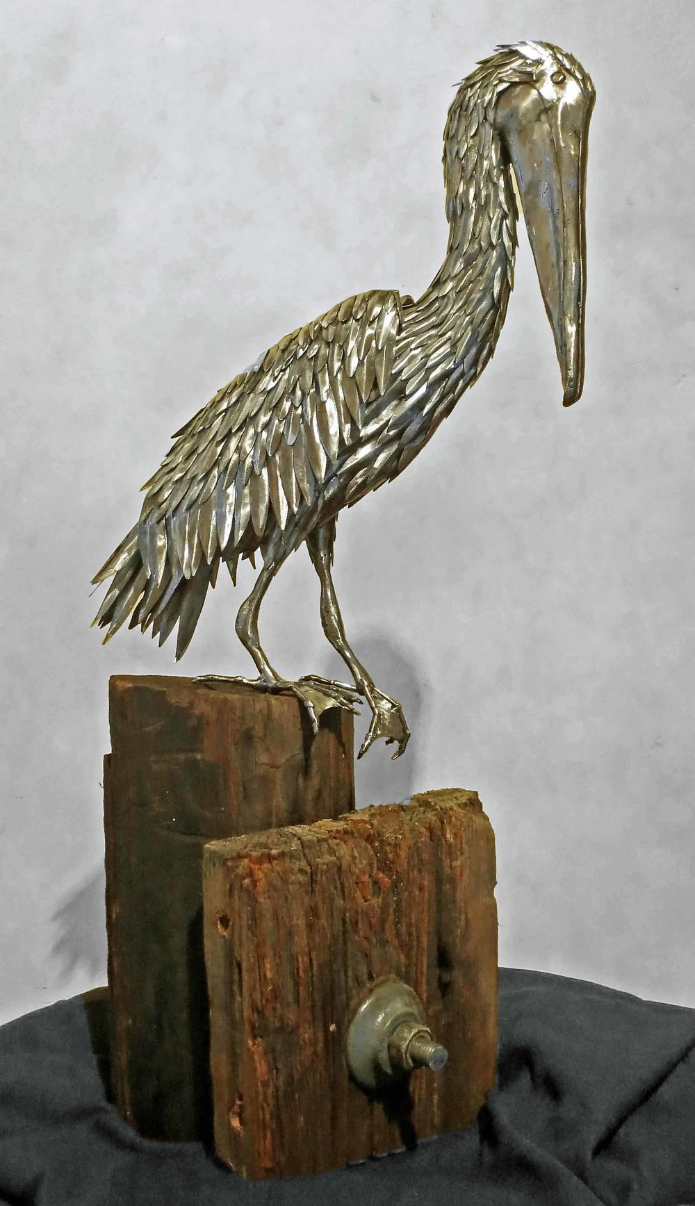 "Sold   ""Respite""  Steel Pelican Atop Reclaimed Wood Post"