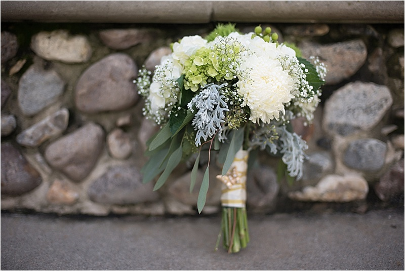 gold and ivory wedding bouquet with greenery