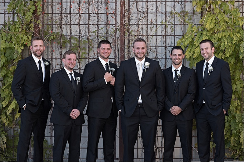 black suit groomsmen fall wedding